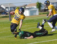 Above, the Grande Prairie Drillers' Owen Zawyrucha dodges a Lloydminster Vandals' tackle in Alberta Football League play at St. Joseph High school Saturday.