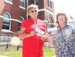 Huron East economic development officer Jan Hawley and Maureen Agar display the Go Postal postcards promoting Canada Day events in Seaforth on July 1.