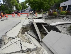 Flooding has caused parts of the road to collapse into giant sink holes in Calgary on June 24, 2013. (GAVIN JOHN/QMI Agency)