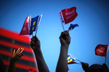 People wave marriage equality flags in West Hollywood, California after the United States Supreme Court ruled on California's Proposition 8 and the federal Defense of Marriage Act June 26, 2013. (REUTERS/Lucy Nicholson)