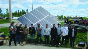 Court Seymour Etherington, Peter Iserhoff, Max Robert Cohnstaedt, Joel Robin, Christopher White, Morgan Hunter, Bernard Whiskeychan-Hunter, Kynewh Enosse, Simeon Edwards, Brett Filion and Ryan Prevost in front of the solar panels they constructed through the Apitisawin Construction and Solar Fundamentals program.
