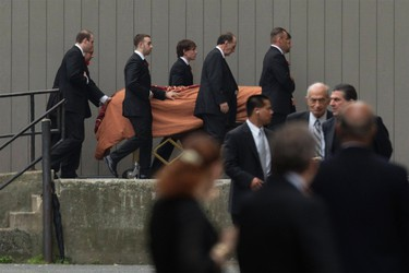 The casket of actor James Gandolfini is escorted into the Cathedral Church of Saint John the Divine for funeral services in New York June 27, 2013. Gandolfini died in Rome on June 19, 2013 after suffering a heart attack at the age of 51. REUTERS/Lucas Jackson (UNITED STATES - Tags: ENTERTAINMENT OBITUARY)