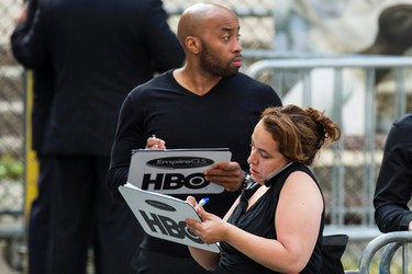 """Representatives from HBO hold clipboards outside the funeral services of James Gandolfini outside the Cathedral Church of Saint John the Divine in New York June 27, 2013. Family, friends and fans of Gandolfini gathered at a Manhattan cathedral for his funeral on Thursday, a week after the 51-year-old star of the HBO television show """"The Sopranos"""" died of a heart attack while visiting Rome. REUTERS/Lucas Jackson (UNITED STATES - Tags: ENTERTAINMENT OBITUARY)"""