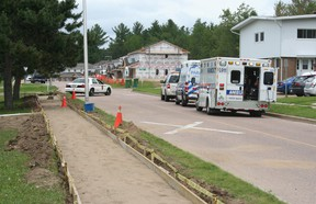 """SEAN CHASE   Ambulances sit outside General Lake Public School Friday afternoon as OPP officers search for a suspect in what they have described as a """"serious incident."""""""