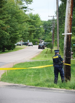 An OPP officer cordones off a stretch of Victoria Road leading to East Street in Petawawa, where police found an adult man dead and two women, one adult and one teenager, seriously injured on Friday morning. After a brief but massive manhunt, a 25-year-old suspect was arrested and now faces murder charges.