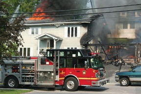Flames and thick smoke encase a home on Robertson St. on Sunday, June 30. The fire started in the garage of the house some time before 5:00 pm although the cause has yet to be determined. GRACE PROTOPAPAS/KENORA DAILY MINER AND NEWS