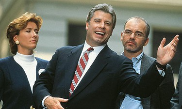 THE PRESIDENT AS HORN-DOG: John Travolta as President Jack Stanton in the thinly-veiled Clinton satire Primary Colors.