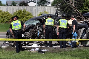 Police investigates a single vehicle accident on 127 Street and 148 Avenue in Edmonton, Alberta on Sunday, July 1, 2013.  The truck was carrying fireworks and pyrotechnic supplies.  Perry Mah/Edmonton Sun/QMI Agency