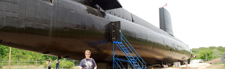 Melissa Raven, director of communications for Project Ojibwa, stands outside the HMCS Ojibwa submarine at Port Burwell in this file photo. (Ben Forrest, Times-Journal)