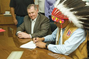President of ATCO Pipelines, Brendan Dolan(Left) and Ermineskin Chief, Craig Manikaw, both finalizing the deal between the community and the company on June 27