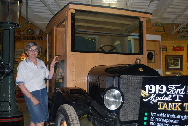 Marlene Colledge, a curator at the Karn Family Collection museum near St. Thomas, stands with a 1919 Model T tank truck. The truck appeared in the 2009 film Amelia, starring Richard Gere and Hilary Swank. In its workig days the truck was also used to haul coal oil, gasoline and diesel fuel, Colledge said. It's one of thousands of items at the museum, which is mainly made up of items collected by the late Jack and Joyce Karn, former owners of Dowler-Karn Ltd. (Ben Forrest, Times-Journal)