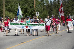 From Town of Canmore employees to fire and recue personnel and heavy equipment operators, Canmore's flood response team received a strong ovation from the town as they made their way downtown during Monday's Canada Day parade. Justin Parsons/ Canmore Leader/ QMI Agency
