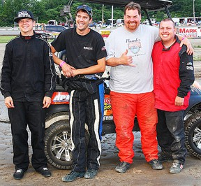 Custom Cart pole-sitters, from left, Tom Vance, Charlie Sandercock, Doug Anderson and Adam Whaley during the Brighton Automotive Canada Day championships.