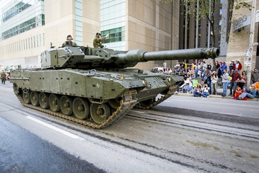 A tank makes its way through the Calgary Stampede Parade in downtown Calgary, Alta. on Friday, July 5, 2013. Massive flooding two weeks earlier put the annual parade in jeopardy, but it came together just in time for the Stampede's 101's year. Lyle Aspinall/Calgary Sun/QMI Agency