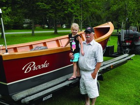 Carol Laplante and his great-granddaughter Brooke stands by his handmade boat, which has been 45 years in the making.        Wayne Lowrie - Gananoque Reporter