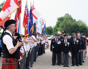 Piper Dick Laurie and colour parties from the Woodstock and Stratford Naval Veterans Associations prepare to lead Ojibwa submariners to their places of honour Saturday morning in Port Burwell. Jeff Tribe/Tillsonburg News