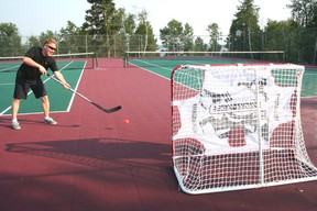 Joe Banfield shoots a road hockey ball into one of the nets on the tennis courts at the Royal Lake of the Woods Yacht Club. For the first time ever, the Yacht Club will be offering an adult ball hockey league on Sunday nights and youth league on Wednesday nights.  GRACE PROTOPAPAS/KENORA DAILY MINER AND NEWS