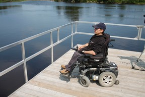 Timmins resident John Bolduc takes in a view of the Mattagami River Monday morning where he usually enjoys kayaking. However, last week while going for an afternoon, he returned to the boat launch to find that his wheelchair had been stolen. Although the chair was eventually returned, the idea that it could happen again remains a nagging concern to him.
