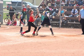 """Pitcher Alexa Hangs works to cover the plate during the Melfort Heat's 19-12 loss to the Kindersley Royals on Sunday, July 7 at Spruce Haven Ballpark as part of the 2013 Softball Saskatchewan """"C"""" Girls Provincials"""