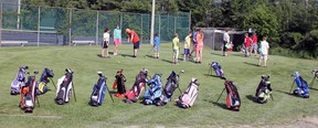 Golf bags encircle the practice putting green as junior golfers recieved their first day of lessons. While some practised their chipping, others practised their putting while a group perfected their drive.  Photo by Dawn Lalonde/Mid-North Monitor/QMI Agency