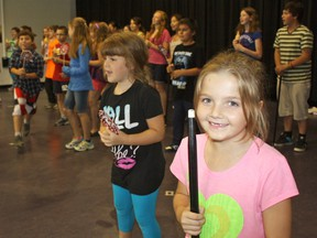 Serena Gravel, left, and Isabella MacPhail are among the many talented young actors who have been rehearsing for their upcoming performance of Willy Wonka Jr. on the weekend. The play, based on Roald Dahl's children's classic Charlie And The Chocolate Factory, is put on annually as part of a two-week camp by theatre company Lock and Keynote Productions. The show will be staged Friday and Saturday and École publique Renaissance.