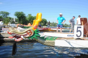 Onlookers watch as a dragon boat is launched into Ramsey Lake. The Sudbury Dragon Boat Festival goes this Saturday at Bell Park. GINO DONATO/THE SUDBURY STAR
