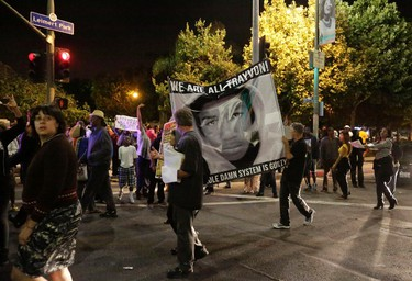 Protesters march in the Leimert Park area of Los Angeles, California, following the George Zimmerman verdict, July 13, 2013. A Florida jury acquitted Zimmerman on Saturday for the shooting death of unarmed black teenager Trayvon Martin, setting free a man who had become a polarizing figure in the national debate over racial profiling and self-defense laws. REUTERS/Jason Redmond