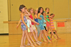 The girls show of their dance routines for Inglenook Studio's Dance and Art Camp wrap-up at Pope John Paul ll School on Friday afternoon. MARNEY BLUNT/DAILY MINER AND NEWS