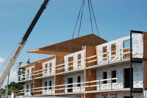 The roof went up on the new apartment buildings behind the Legion Place in Melfort on Thursday, July 4.