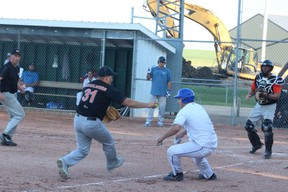 Todd Desaulniers of the Melfort EP 3000s has a member of the Prince Albert Blue Jays caught in a run down during Melfort's 9-6 loss to the Blue Jays on Wednesday, July 10 at Spruce Haven Ballpark.