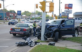 A three-vehicle collision at the intersection of Pembroke and Howard streets on Tuesday afternoon caused traffic headaches for drivers on both main cross-town thoroughfares, as police worked to clear the scene. A Dodge Ram pick-up truck bore the brunt of the damage after it slammed into a traffic light post. Paramedics attended the scene, but there were no serious injuries reported. Police are still investigating the cause of the collision.