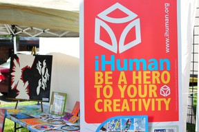 iHuman Youth Services sold T-shirts, paintings and dream catchers made by Edmonton youth at the Whyte Avenue Art Walk last weekend, Photo by Trevor Robb/Edmonton Examiner