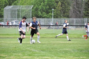 Canmore United's Ivan Babikov chases after the ball during the team's game against the Pump & Tap Tavern on Sunday, July 14, 2013. Canmore United won 2-1. CORRIE DIMANNO/ CRAG & CANYON/ QMI AGENCY