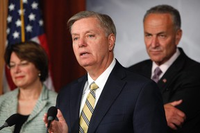 U.S. Senator Lindsey Graham (R-SC) and Senator Chuck Schumer (D-NY) (R) speak during a push for new bipartisan media shield legislation during a news conference at the U.S. Capitol in Washington, July 17, 2013. REUTERS/Jonathan Ernst