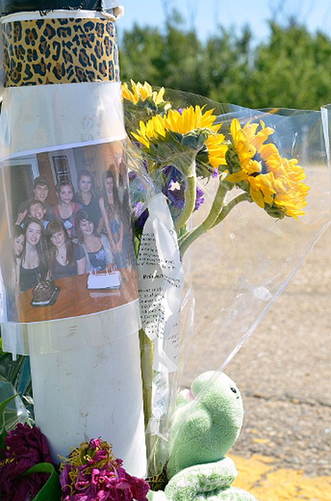 A roadside memorial at the intersection of Highway 16 and Range Road 213, set up in memory of Logan Torresan, 14, and Dalin Torresan, 17, two Strathcona County, Alta. brothers who died in a Monday, July 15, 2013 collision at that location. Michael Di Massa/Sherwood Park News/QMI Agency