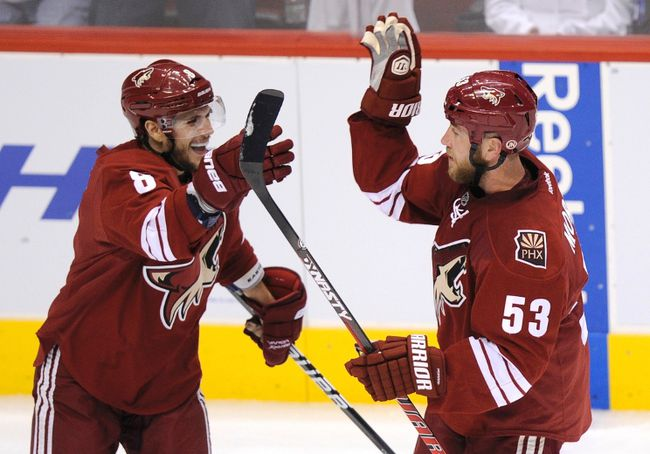Phoenix Coyotes defenceman Derek Morris (right) celebrates a goal against the Los Angeles Kings with teammate Gilbert Brule during Game 1 of the NHL Western Conference final in Glendale, Arizona, May 13, 2012. (REUTERS/Todd Korol)