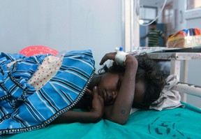 A sick child rests at a hospital after consuming contaminated school meals in the eastern Indian city of Patna July 17, 2013. At least 22 children died and dozens were taken to hospital with apparent food poisoning after eating a meal provided for free at their school in the Indian state of Bihar, officials said on Wednesday, sparking violent protests. (REUTERS/Stringer)