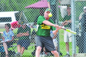 Portage Agri-Sales' Don Giercke takes a swing during the Agri-Sales finale in the Portage Senior Slo-Pitch Tournament July 18. (Kevin Hirschfield/The Graphic/QMI AGENCY)