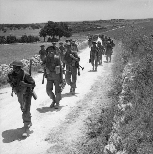 The 2nd Seaforth Highlanders advance through Sicily during the long march inland on July 11, 1943.