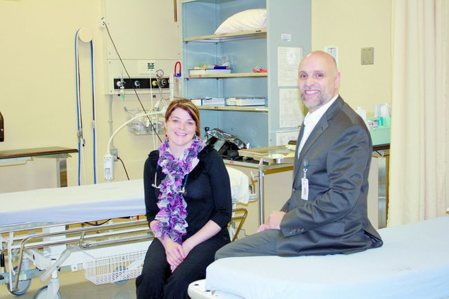Rachel Thompson, left, poses with Paul Rosebush, president and CEO of the South Bruce Grey Health Centre.