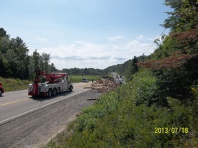 Tractor trailer carrying logs has closed section of Hwy 17 W past Webbwood