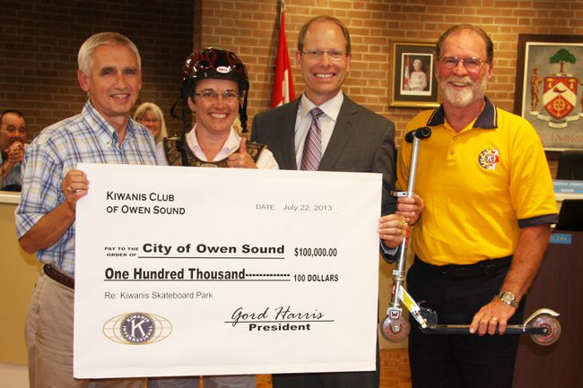 Kiwanis Club president Gord Harris, right, and club member Paul Kirk, left, pose with Mayor Deb Haswell and Coun. Jim McManaman at Monday's night's council meeting.