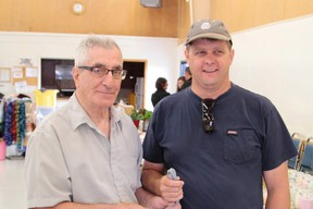 Eli Vuksanovich, left, is stepping down as manager of the Mountjoy Indepndent Farmers' Market and has passed responsibility over to Timmins farmer Allen Graham.