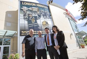 London Knights General Manager Mark Hunter, left, stands outside of Budweiser Gardens with Dwayne Blais, Director of Hockey Operations for Total Package Hockey Canada, Blyth Academy VP of Admissions and Recruitment Cameron Harvey, and Blyth Academy Head of School for London Jennifer Flynn-Clark, after an announcement the three are partnering together to open a hockey academy.  The group is pictured here in London on Wednesday July 24, 2013. (CRAIG GLOVER, The London Free Press)