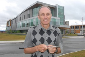 Colin Kirkwood, dean of Sault College's school of business, helps launch a new partnership for students interested in studying golf management with the Sault Ste. Marie post-secondary institution and Humber College. The photo was taken Friday, July 19, 2013.