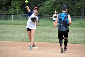 The Eddie Trashcans' Tarsha Autio makes the out at second base and throws to first during the team's game against Melissa's/Taxi Taxi on Sunday, July 21. The Trashcans won 14-12. CORRIE DIMANNO/CRAG & CANYON/QMI AGENCY
