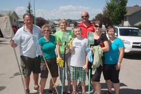 Members of the congregation of the St. Andrew's United Church were in High River, last Saturday helping to clean homes hit hard by the flood. From left are Gary and Carol Webb, Sandra Brinson, Connall MacLeod, Dan Paarsmarkt and Billy MacLeod.
