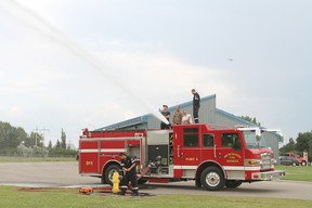 Potential firefighters get a chance to see the Pump Truck 4 in action during a recruitment information evening at the Wetaskiwin Fire Hall July 18.