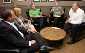 Minister of state Gary Goodyear, second from right, and Prince Edward-Hastings MP Daryl Kramp, right, meet with local dignitaries at Kramp's office in Belleville Wednesday. From left are Quinte Economic Development Commission executive director Chris King, Belleville economic development manager Karen Poste and Hastings County chief administrative officer Jim Pine.