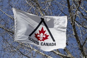A flag waves outside the Scouts Canada Service Centre in Calgary on March 30, 2011. (LYLE ASPINALL/ QMI AGENCY)
